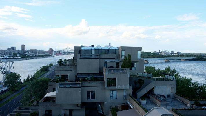 View of Habitat 67 (1967), with the Montreal Biosphère (Former US Pavilion at Expo 67, 1967; repurposed 1995) in the background. Photo: David Theodore 2017.