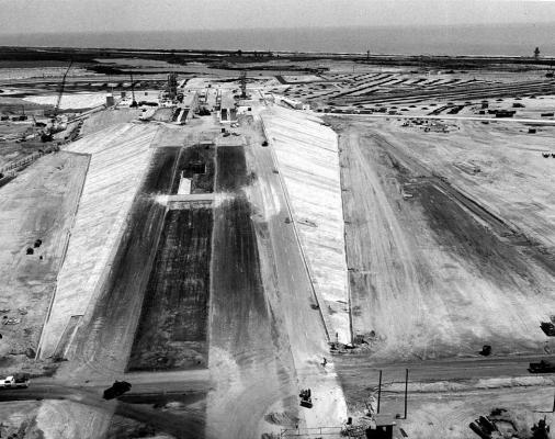 Figure 4. Aerial of launch complex 39a construction, Cape Canaveral, January 1965; launch complex 39 was built for Apollo Saturn rocket launches and was modified for use by the space shuttle. Private launch company SpaceX signed a twenty-ye…