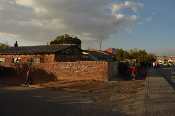 Figure 2: eNtokozweni Community Centre seen from London Road. The eNtokozweni Community Centre beyond its perimeter wall. In the foreground sits the original structure in which Former President Mandela boxed and jazz musician Hugh Masekela …