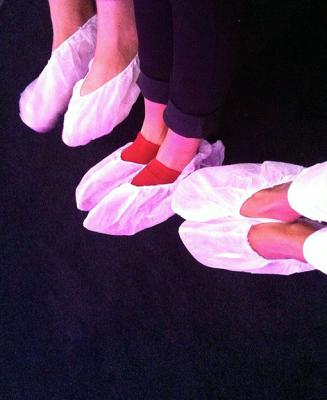 Figure 3. Museum goers wearing foot booties before entering the installation, Light Reignfall (2011).  Credit: Rosie Thomas.