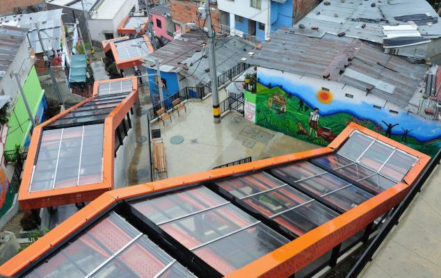 Medellin's electric escalators in informal barrios. (Credits: reproduced with authorization of the Planning Department of the City of Medellin.)
