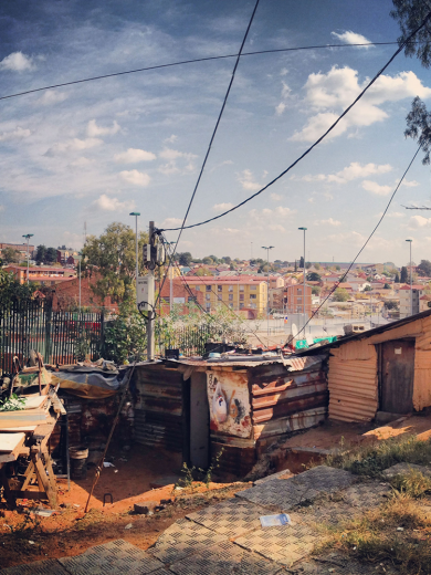 Figure 4b: Alexandra Township. High-density provisional houses in the foreground juxtaposed against formal housing development of external forces beyond.